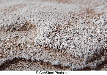 White Mineral Deposit on Desert Rocks Close Up