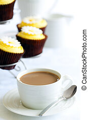 Afternoon tea or coffee served with a selection of cupcakes