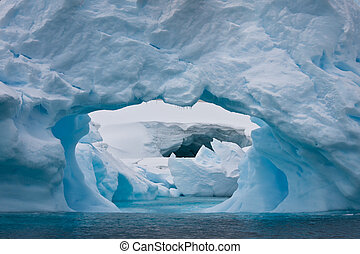Antarctic iceberg - Large Arctic iceberg with a cavity...