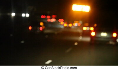 yellow road sign at night - night freeway driving with a...
