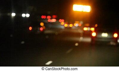 yellow road sign at night