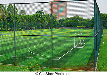 a soccer field behind the fence