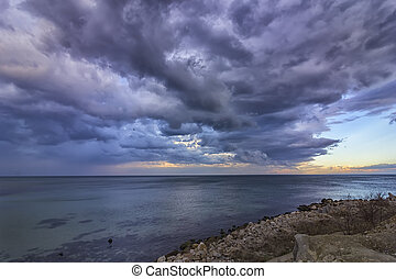 Exciting calm seascape with stormy clouds