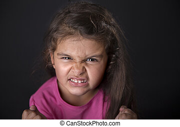 Angry four years girl - Portrait of a funny and angry four...
