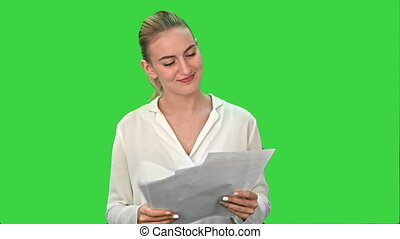 Happy woman finish project and throws scraps of paper on a Green Screen, Chroma Key.