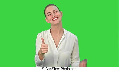 Happy excited woman showing approval hand gesture thumb up and smiling on a Green Screen, Chroma Key.