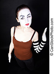 woman mime with theatrical makeup on black background