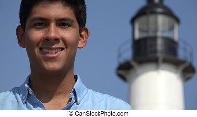 Happy Teen Boy At Lighthouse