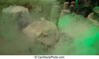 Barmen uses liquid nitrogen in a bar