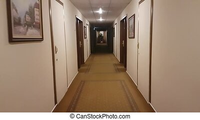 POV walking in hotel corridor. Nobody