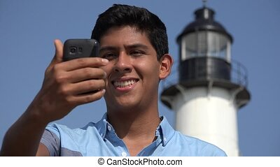 Teen Boy Lighthouse Selfie