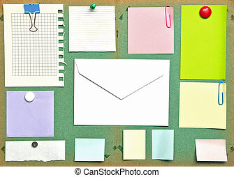 bulletin board with notes, business cards and envelope