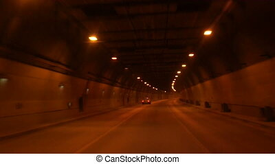Tunnel road at night. - Tunnel road in a city at night.