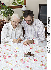 Grandma signs the contract documents.The contract of...