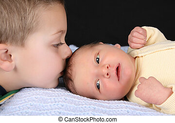 Brothers - Blond boy with his newborn baby brother