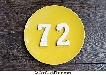 The number seventy-two on the yellow plate.