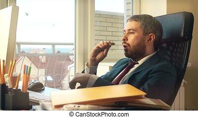 Young caucasian businessman having short break at his...