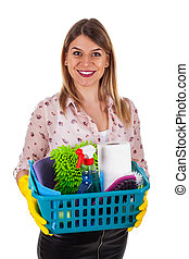Smiling woman holding cleaning supplies - Picture of a...