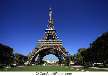 Eiffel Tower in Paris on a background of the blue sky....