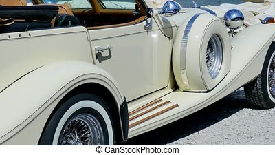 Old beige cabriolet near the sea.