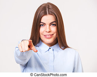 Young beautiful business woman pointing at you while...