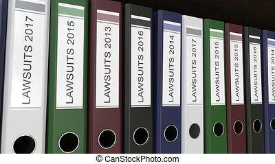Line of multicolor office binders with Lawsuits tags...