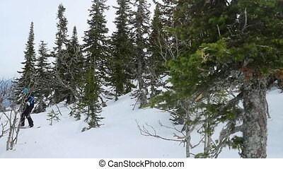 Snowboarder riding in ski winter mountains in slow motion....