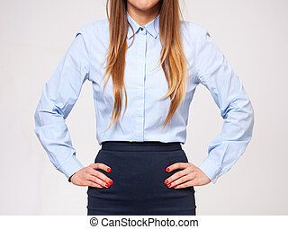 Midsection of young business woman standing in formal dress....