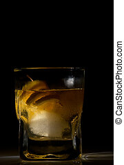 Whiskey sour cocktail isolated on black background