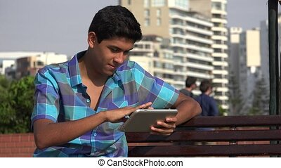 Teen Boy Using Tablet