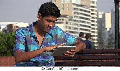 Teen Boy Using Tablet