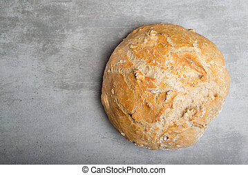 Fresh round bread on a concrete table