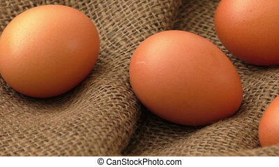 Chicken eggs on brown burlap