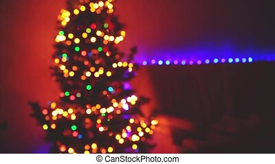 Blinking Christmas Tree blurred Lights bokeh. Winter...