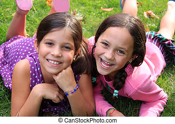 Best friends or sisters - Two young girls in the ages of ten...