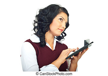 Thinking woman using calculator