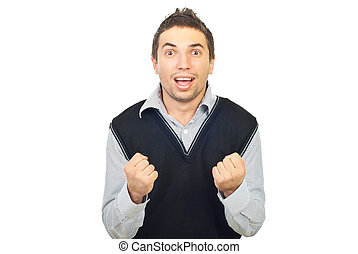 Cheering young man showing his fists isolated on white...