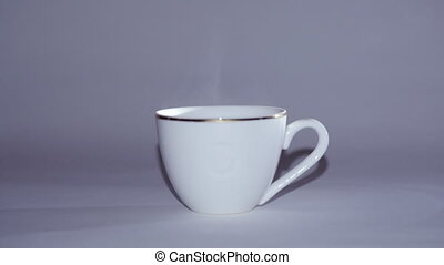 white Cup of hot tea or coffee, steam comes