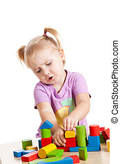 little girl playing with toy blocks - studio shot of little...