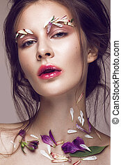 Beautiful girl with art make-up and flowers. beauty face.