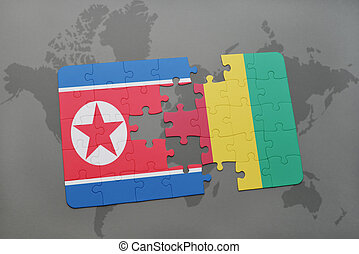 puzzle with the national flag of north korea and guinea on a...