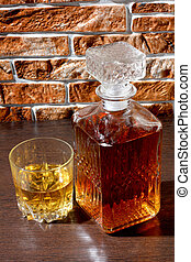 Whiskey glass and wall three - Glass and bottle wine on...