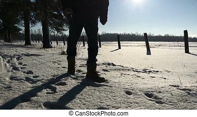 Man legs kicking snow in the daytime. Video full hd.