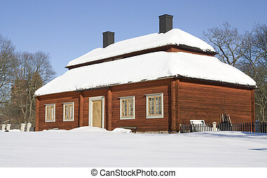 House - A photo of an house in Stockholm covered by snow