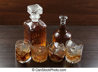 Glass whiskey on wood seven - Glass and bottle wine on...