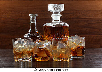 Glass whiskey on wood three - Glass and bottle wine on...