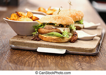 Two delicious wurst burgers served with french fries,...