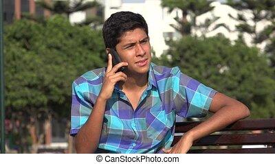 Teen Boy Talking On Phone