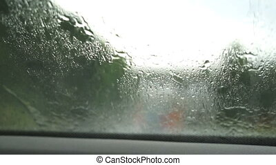 Car wipers are removing rain. - Car wipers are removing rain...