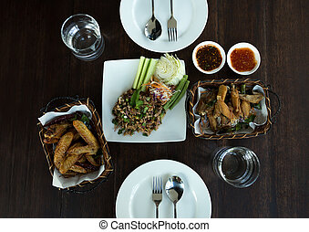 Food concept Thai Spicy minced pork salad with chicken wings...